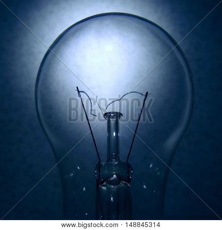Broken tungsten filament inside electric bulb detailed