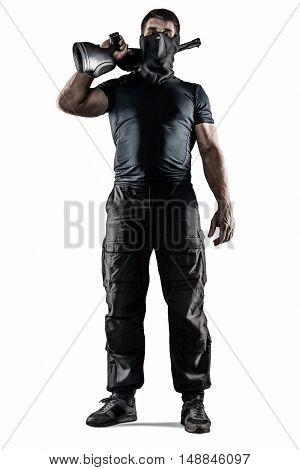 Man in headgear wearing black military uniform holding rifle isolated on white background