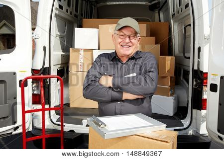 Mature delivery man with a parcel.