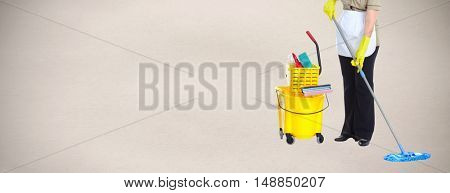 Housewife cleaning floor with mop.