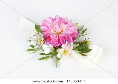 Pink wrist corsage isolated on white background