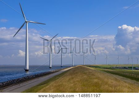 Row Of Windturbines Along A Dike
