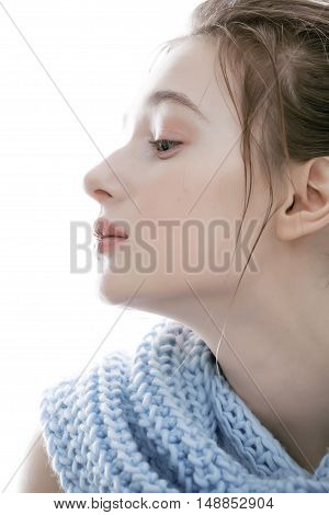 beauty young blond real woman in scarf with weathered lips close up isolated, dirty winter hair, pale skin