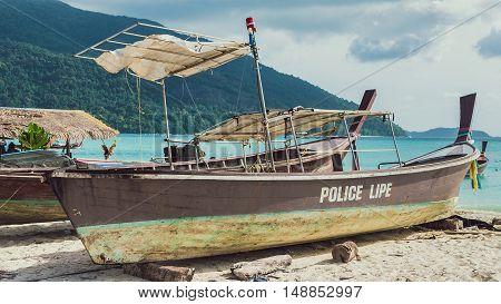 Old Police Boat on Sand Beach on Koh Lipe Thailand.