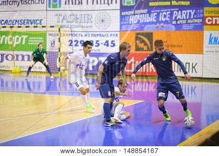 MYTISHCHI, RUSSIA - OCT 16, 2014: Football player running for the ball on the Russian Futsal Super League in the Sports Complex Construction in Mytishchi