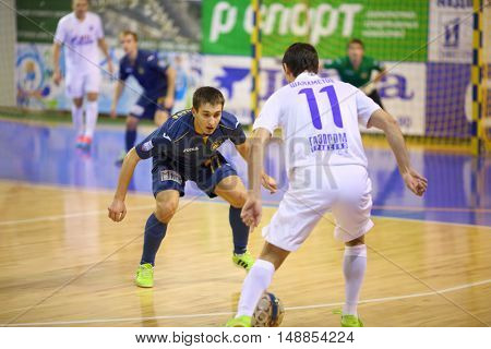MYTISHCHI, RUSSIA - OCT 16, 2014: Player tries to intercept the ball on the field on the Russian Futsal Super League in the Sports Complex Construction in Mytishchi