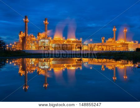 Power plant with water reflection at sunrise.