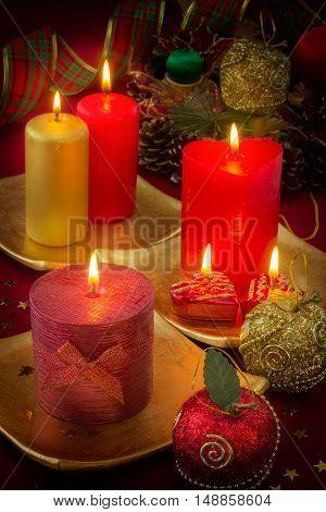 Burning candles with Christmas decoration Xmas background