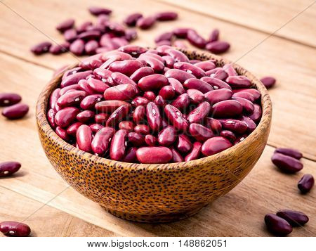 Close Up Red Kidney Beans In Wooden Bowl On Wooden Background. Selective Focus Depth Of Field.