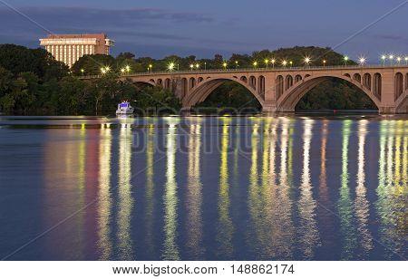 Key Bridge before sunrise in Washington DC USA. Key Bridge and lights reflection in waters of Potomac River.