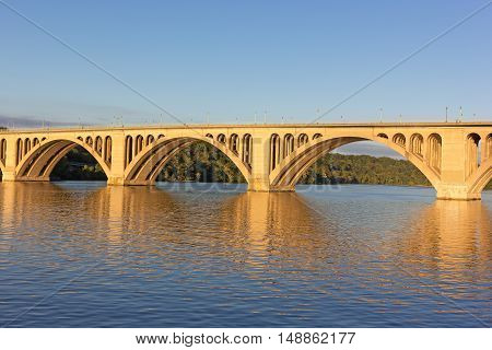 A sunrise over Key Bridge in Washington DC. A view on Key Bridge over Potomac River from the District of Columbia USA.