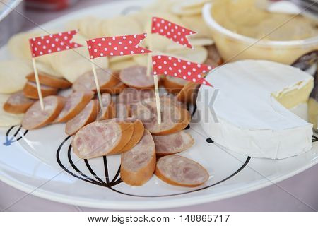 cheese sausage platter with red cocktail picks