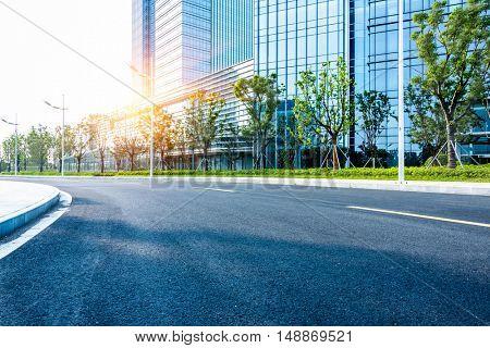 clean asphalt road through office block area,suzhou,china.