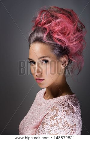 Portrait of a beautiful girl with dyed hair professional hair colouring on grey background