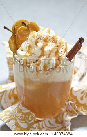 Apple cider float with whipped cream and caramel sauce