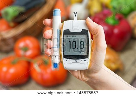 Diabetic Diet And Healthy Eating Concept. Glucometer And Vegetab