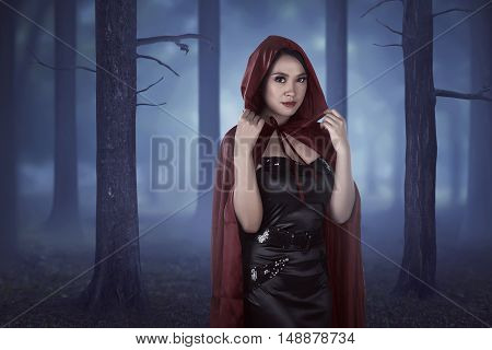Beautiful Asian Girl Wearing A Red Hooded Cloak