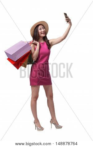 Beautiful Asian Girl Holding Shopping Bags And Taking Selfie With Cellphone