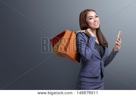 Shopping Time, Asian Woman With Smartphone Holding Shopping Bags