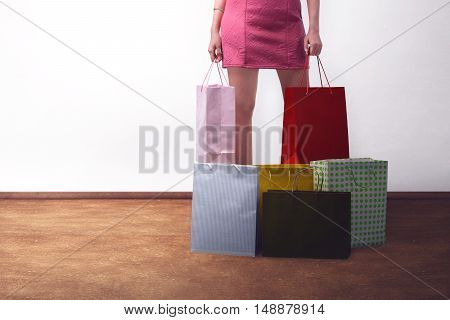 Young Trendy Woman Wearing Pink Dress With Shopping Bags