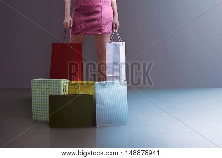 Beautiful Young Woman Standing With Shopping Bags And Boxes