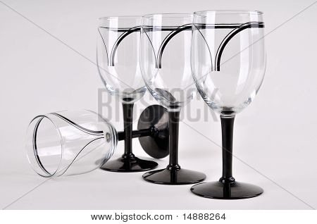 Four wine glasses on a table