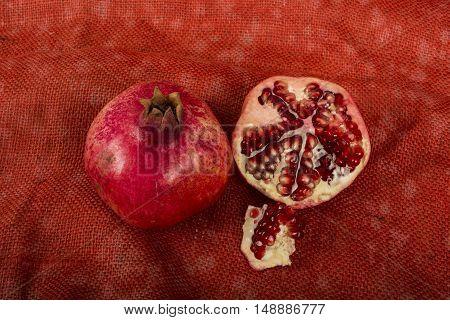 Pomegranates on a red burlap yuta background