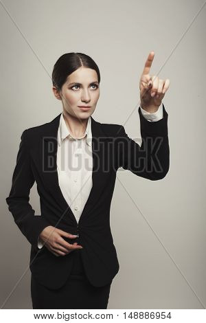 Business Woman Pushing Button  Isolated  Studio Shot