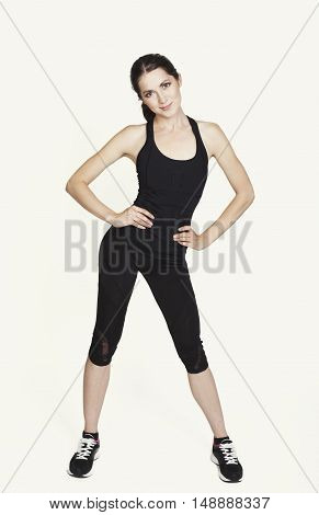 Young Happy Woman In Black Sports Wear