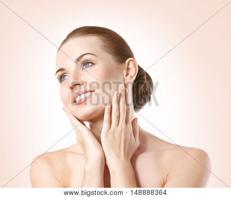 Beautiful young woman with on color background. SPA concept.