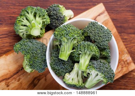 fresh broccoli on a wooden table
