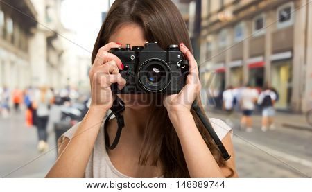 Portrait of a female photographer using a camera