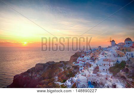 famouse sunset of Oia over Aegan seal, night over Santorini island, Greece