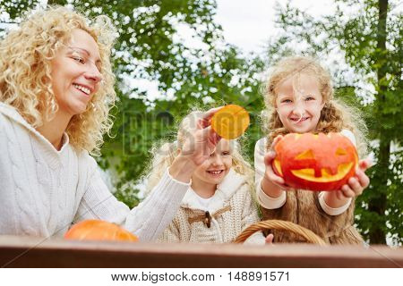 Grils playing with Halloween Hokkaido pumpkins in the fall