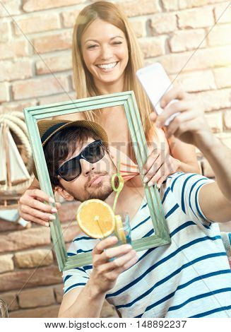 Happy couple making selfie on summer holiday, having fun, laughing.