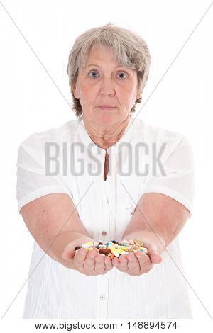 Senior woman with hands full of pharmaceuticals
