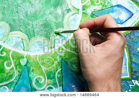 Closeup Of Man Painting Green Picture With Circle Pattern, Mandala Of Anahata Chakra