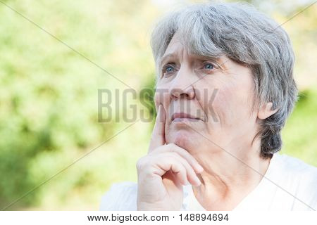 Thoughtful old age woman