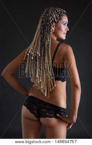 woman with dreadlocks in underwear