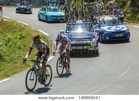Col D'AspinFrance- July 15 2015: The cyclists Tom Leezer of Lotto NL-Jumbo Team and Sebastien Chavanel of FDJ Team climbing the road to Col D'Aspin in Pyrenees Mountains during the stage 11 of Le Tour de France 2015.