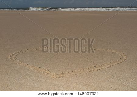 A heart shape drawn in the sand