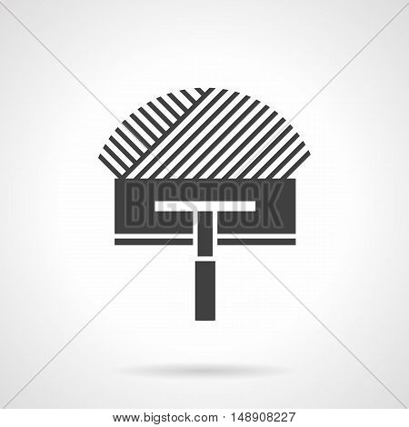 Symbol of trowel with cement or glue. Repairing works and home improvement. Warm floor insulation installing. Construction tools and instruments. Monochrome black flat design vector icon.