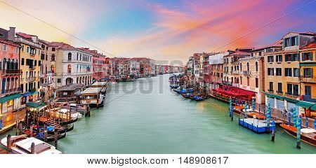 Venice Grand Canal gondolas hotels and restaurants at sunset from the Rialto Bridge