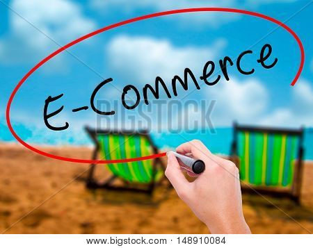 Man Hand Writing E-commerce With Black Marker On Visual Screen
