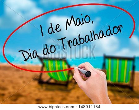 Man Hand Writing  1 De Maio, Dia Do Trabalhador (in Portuguese: 1 May, Labor Day)  With Black Marker
