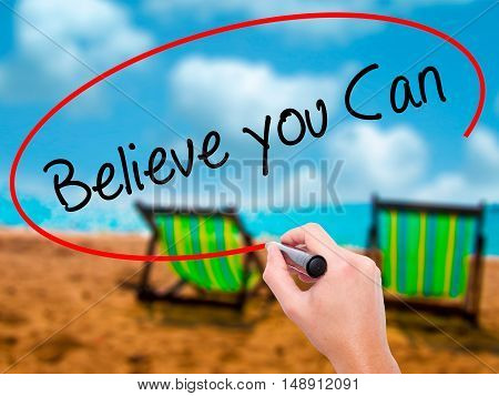 Man Hand Writing Believe You Can With Black Marker On Visual Screen
