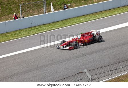 The racer of Ferrari on finish during The Formula 1 Grand Prix at autodrome