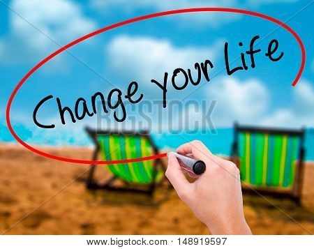 Man Hand Writing Change Your Life With Black Marker On Visual Screen