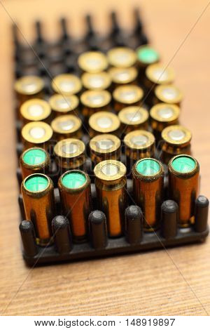Bullets Stock Photo High Quality . bullet for a gun  on wood background.