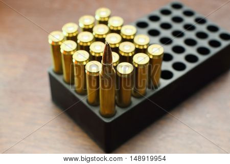 Bullets Stock Photo High Quality . bullet for a gun  on woode background.